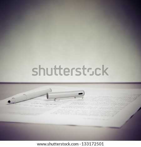 business pen and paper on desk