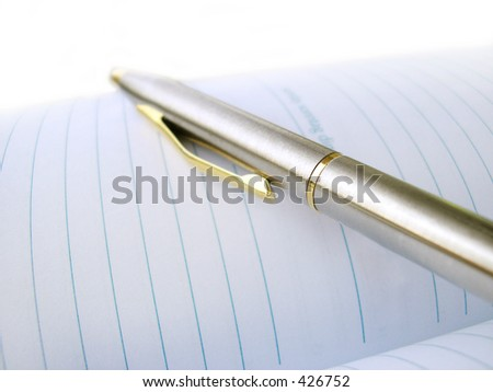 Business Pen On A Note-Book