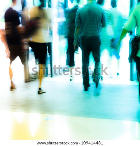 business people activity standing and walking in the lobby motion blurred abstract background