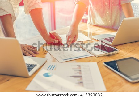 Business people analyzing investment charts. Accounting , with soft focus, vintage tone