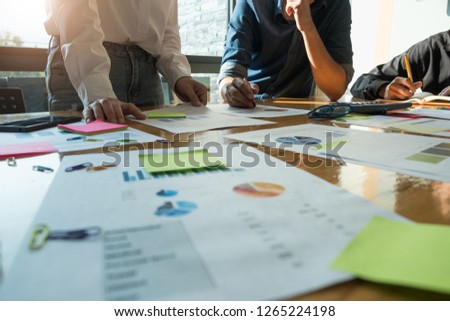 Business People Analyzing Statistics Business Documents, Financial Concept #1265224198