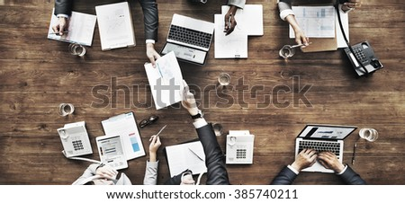 Business People Analyzing Statistics Financial Concept - Shutterstock ID 385740211