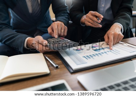 business people and coworker colleagues discussing explanations about week working plan project cooperating in modern coworking office #1389596720