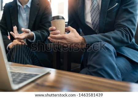 business people and coworker colleagues discussing explanations about week working plan project cooperating in modern coworking office