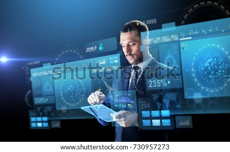 business, people and future technology concept - businessman in suit working with transparent tablet pc computer and virtual screens projection over black background #730957273