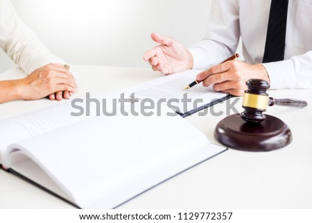 business people and lawyers discussing contract papers sitting at the table. Concepts of law, advice, legal services.