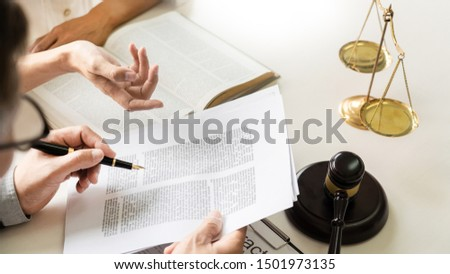 business people and lawyers discussing contract papers sitting at the table. Concepts of law, advice, legal services, legal and judgment concept #1501973135