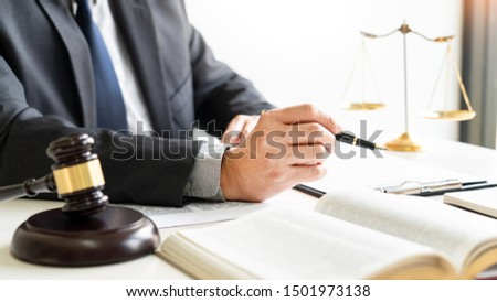 business people and lawyers discussing contract papers sitting at the table. Concepts of law, advice, legal services, legal and judgment concept #1501973138