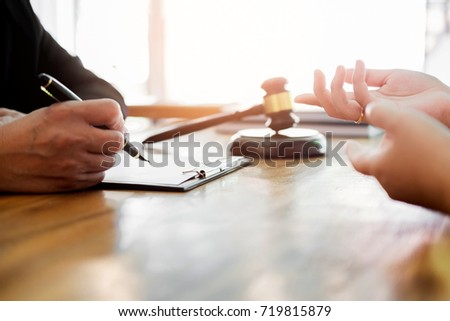 business people and lawyers discussing contract papers sitting at the table. Concepts of law, advice, legal services. #719815879
