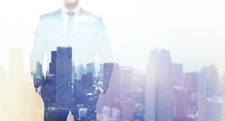 business, people and technology concept - double exposure of businessman over city background