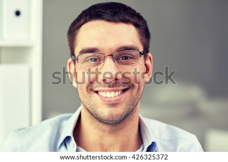 business, people and work concept - portrait of  smiling businessman in eyeglasses in office - Shutterstock ID 426325372