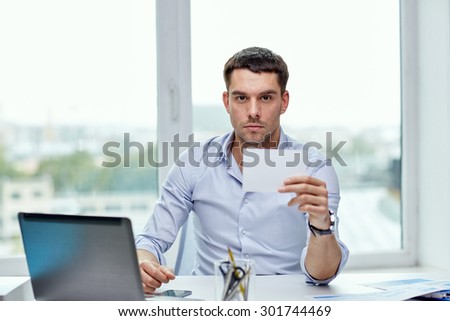 business, people, announcement and advertisement concept - businessman showing blank paper card at office