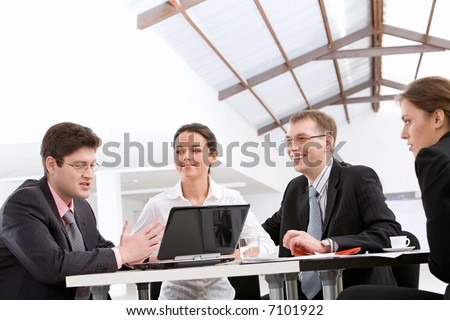Business people are discussing a project at meeting