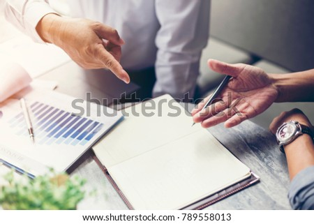 Business people are negotiating business and planning to market. #789558013