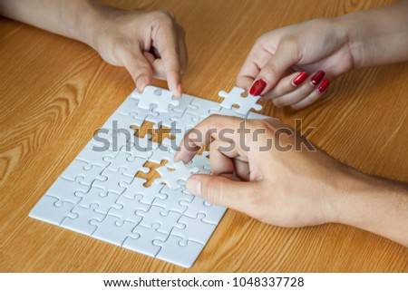 Business people assembling jigsaw puzzle and represent team support and help concept in office, business people assembling jigsaw puzzle and represent team support and help concept #1048337728