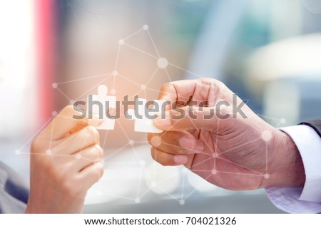 Business People Assembling JIGSAW Puzzle and Represent Teamwork Support in Office with Digital Layer Business Strategy and Social Media Diagram, Partnership SALES Team COllaborate with Competitors