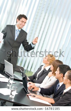 Business people at business meeting, seminar or conference - stock photo