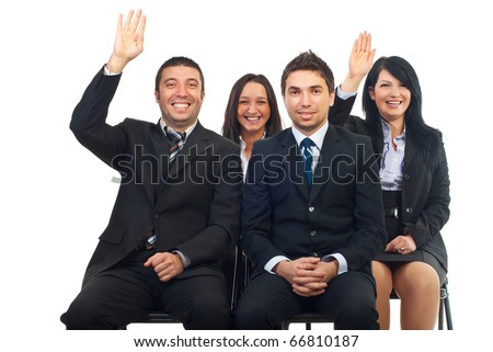 Business people at course or auction raise hands  and laughing