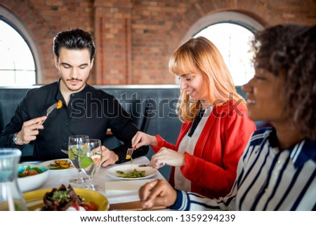 Business people at lunch break in restaurant, multiethnic group #1359294239