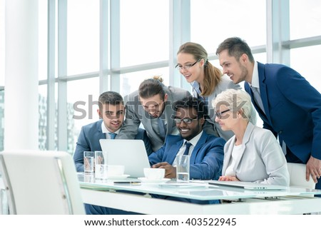 Business people at meeting in office - Shutterstock ID 403522945