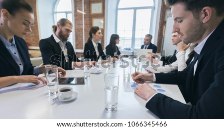 Business people at meeting in office discuss financial charts #1066345466