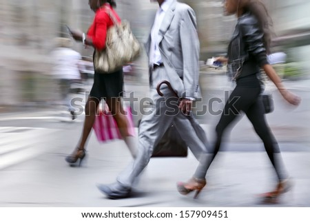 Business people at rush hour walking in the street, in the style of motion blur #157909451