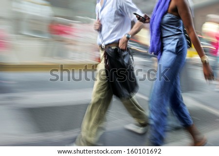 Business people at rush hour walking in the street, in the style of motion blur - Shutterstock ID 160101692
