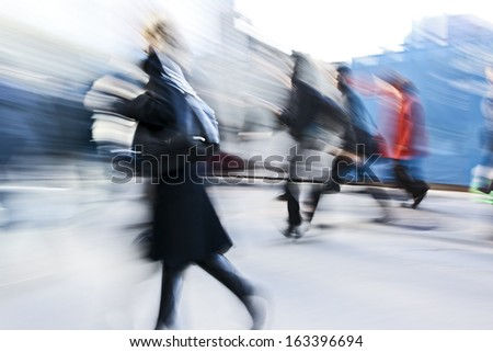 Business people at rush hour walking in the street, in the style of motion blur