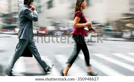 Business people at rush hour walking in the street, in the style of motion blur #350948627
