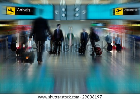 Business People at the Airport Moving with Blur