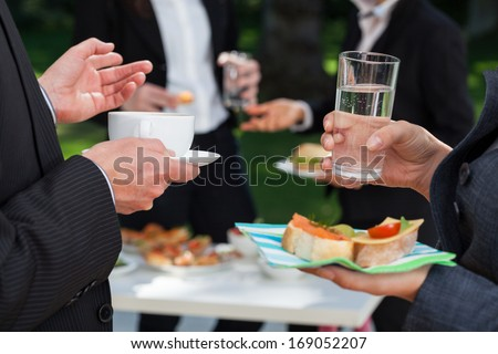 Business people at the meeting at the lunch buffet