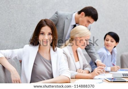Business people at the meeting discuss current issues at the modern office building