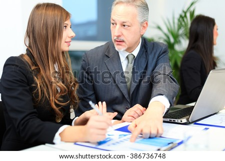Business people at work during a meeting - Shutterstock ID 386736748