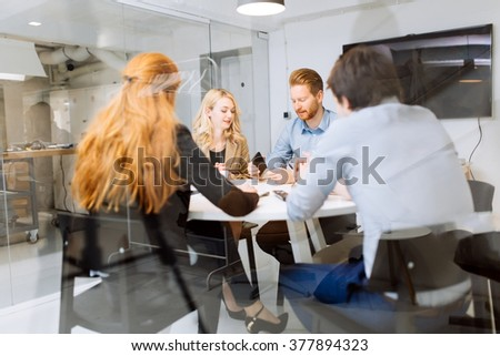 Business people board meeting in modern office while sitting at round table #377894323