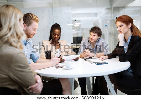 Business people board meeting in modern office while sitting at round table #508501216