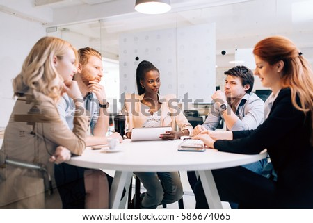 Business people board meeting in modern office while sitting at round table #586674065