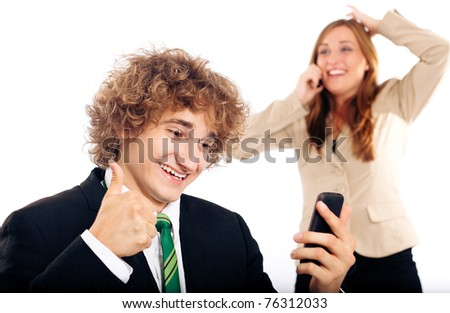 Business people - both are on their mobile phone, both are very happy