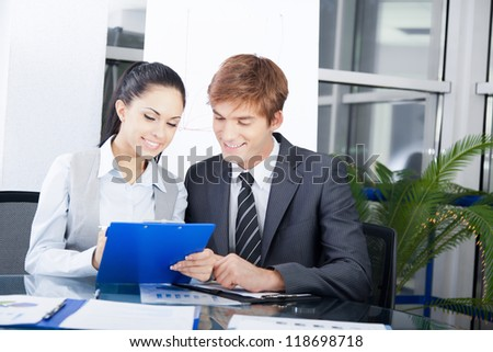 business people businessman and businesswoman working on plan in a meeting at office desk work together, businesspeople colleague team sitting at desk in office discussing report document