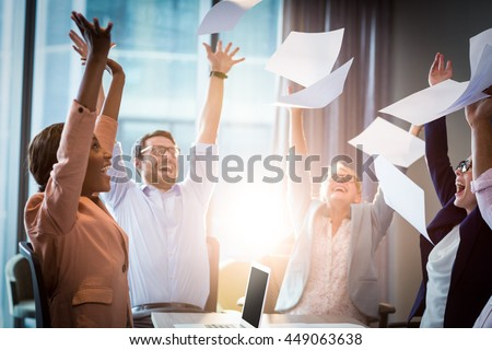 Business people celebrating by throwing papers in the air #449063638