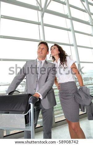 Business people checking flights at the airport