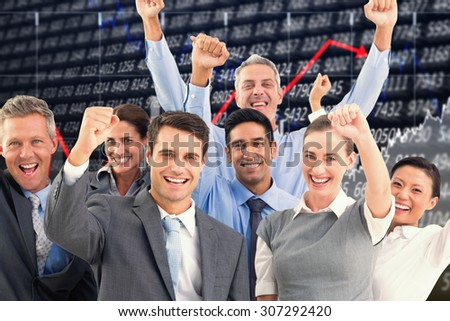 Business people cheering in office against stocks and shares