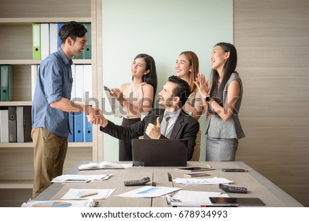 business people clapping in office after signing agreement, Achievement, congratulation and appreciation concept, selective focus