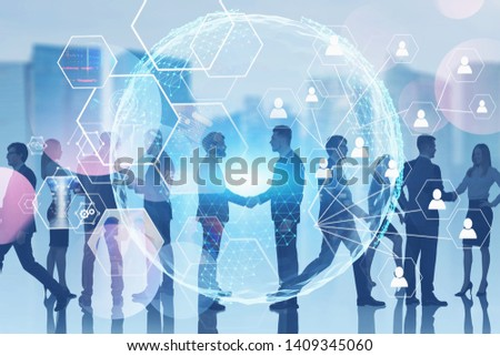 Business people communicating in blurred city with double exposure of planet hologram with social connection icons and digital screens. Toned image. Elements of this image furnished by NASA