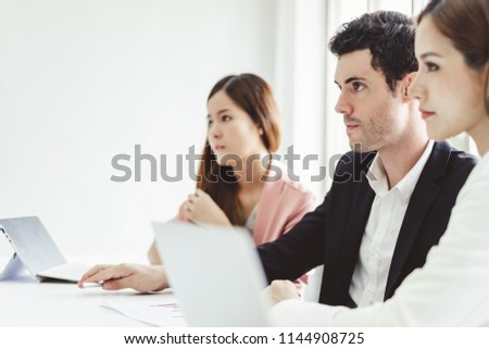 Business people concentrate discussing while meeting in office, working with laptop #1144908725