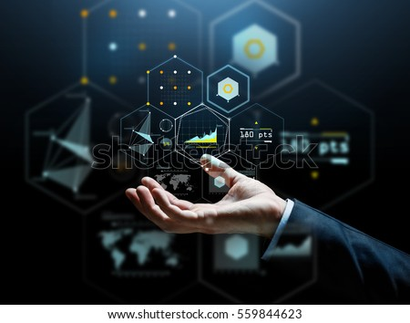 business, people, cyberspace and future technology concept - businessman hand with virtual hologram of charts and projections over dark background