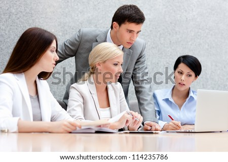 Business people discuss something at the meeting at the modern office building. Target achievement