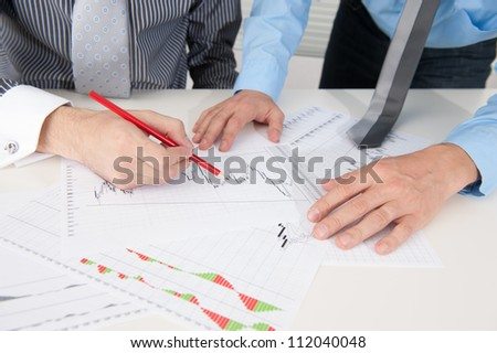 Business people discussing the situation in the stock market