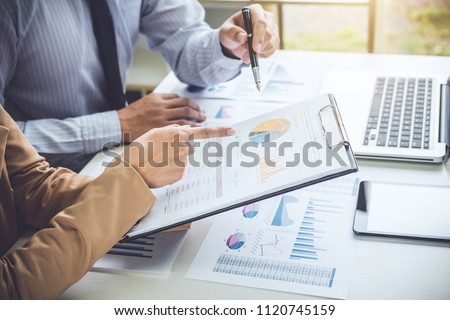 Business people discussion, Executive team discussing the charts and graphs working in business strategy and financial plan to investment profit. #1120745159