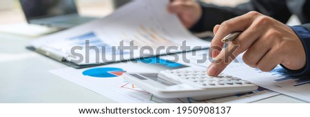 Business people doing budget calculations, finance, taxes, loans, auditors, doing work reports on charts, business financial analysis on the desk or bookkeeping graph. Stock foto ©