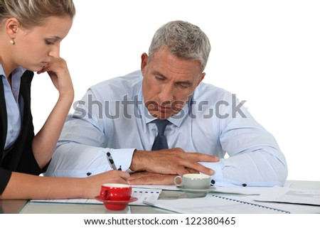 Business people doing paperwork